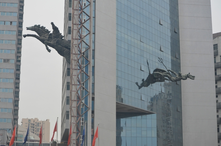 Not sure why they have statues coming out of buildings but in Shenzhen they do.