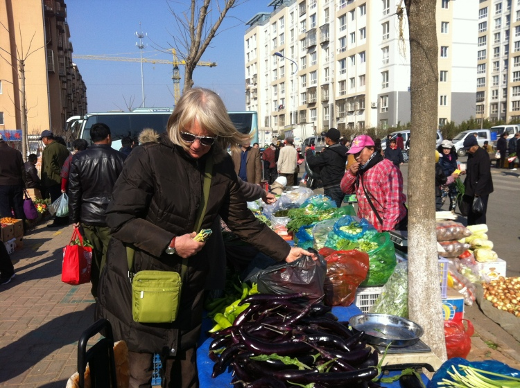 shopping in the Jinshitan market Saturday morning bundled up.