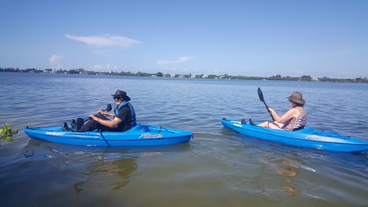 Narda and Terrell kayaking across Lemon Bay and on to Australia